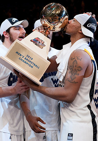 West Virginia's Da' Sean Butler (1) kissing the trophy was voted the Most Outstanding Player of the game at the 2010 Big East Championship title at Madison Square Garden in New York City.