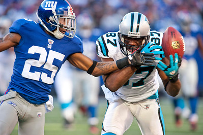 Giants' corner back Bruce Johnson (25) deflects a pass away from Carolina Panthers' wide receiver Muhsin Muhammad (87).