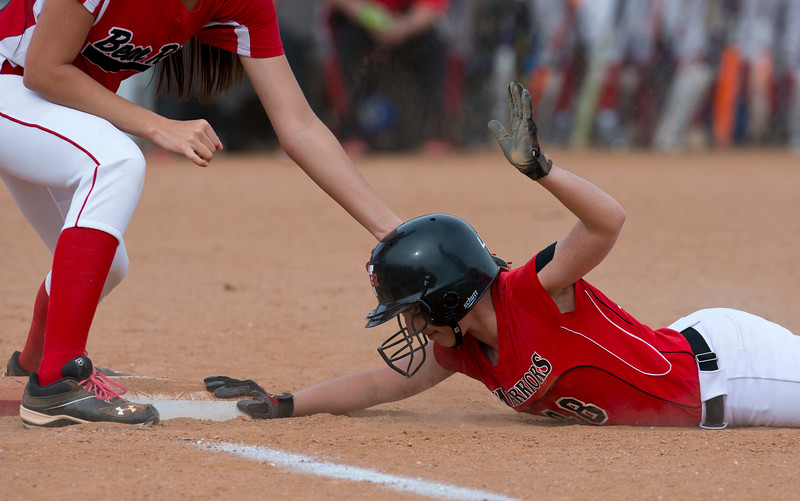 Caitlin Arnold # 48 is safe after nearly being tagged out on first base. Against Bear River. In Pleasant View on March 17, 2015.