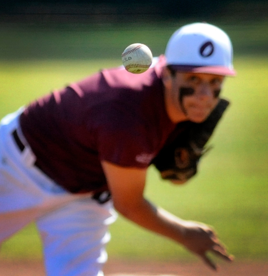 South Coos player Caleb Hennessee pitches to Riddle in the Babe Ruth Southern Oregon State Tournament at Clyde Allen Field on July 15, 2017.