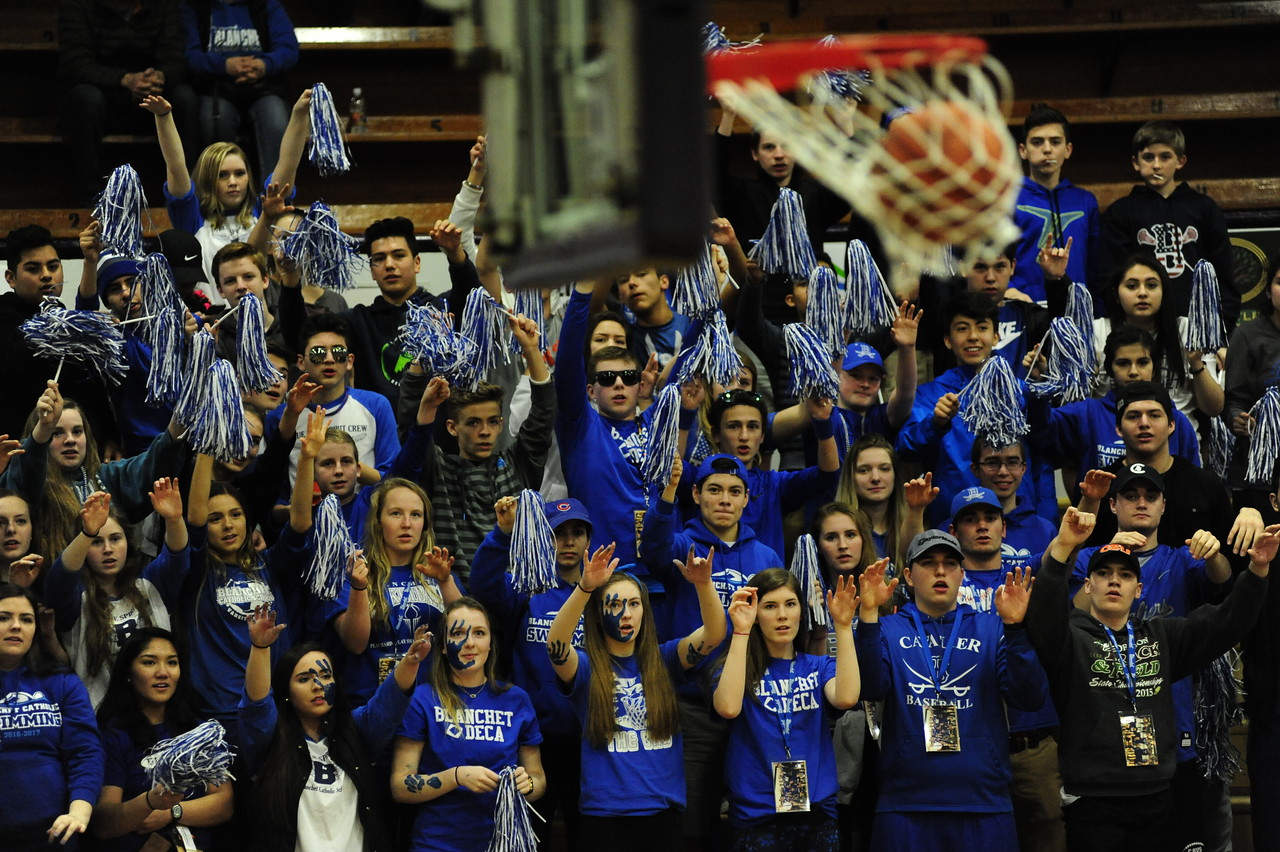 Blanchet Catholic Cavaliers fans react to the final point against the Portland Adventist Cougars in the OSAA 3A basketball quarterfinals at Marshfield High School on Thursday. Blanchet Catholic defeated Portland Adventist 46 to 44.