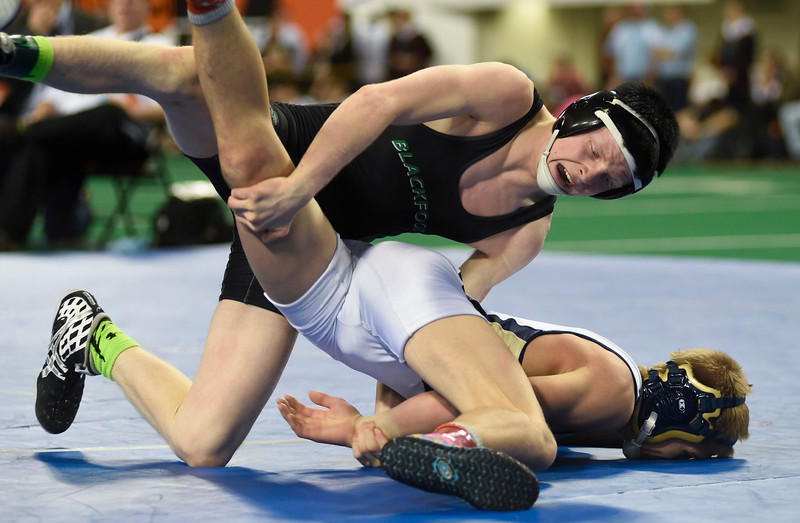Blackfoot's Lane Hunt, top, and Middleton's Laramie Asher, bottom, lock up in the 4A 126 pound championship during the Idaho High School State Wrestling tournament in Pocatello, Idaho, Saturday, Feb. 28, 2015.