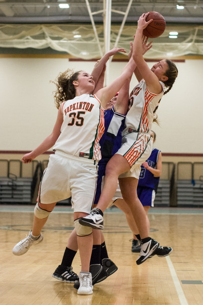January 19, 2010 - Hopkinton, MA, high school freshman Dana Goglin and senior Meg Kessler reach for a rebound in Tuesday night's basketball game against Norton. Photo/Christopher Weigl.