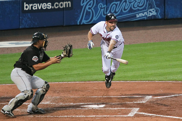 With Andruw Jones on third, Smoltz is given the sign to bunt.  Unfortunately, he lunges at a high-outside pitch.