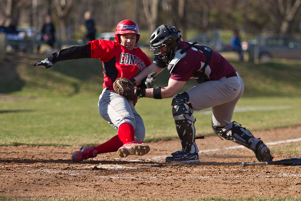Conard's Bobby Marconi is picked off at home by South Windsor's Mike Kelly in West Hartford. South Windsor won 4 to 3.