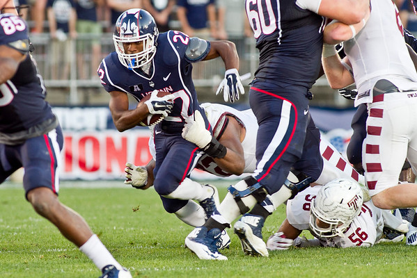 UConn's safety, Andrew Adams moves with the ball before being taken down by Temple's Defensive Lineman, Hershey Walton in the 3rd Quarter against UConn played Temple at Rentschler Field in East Hartford Saturday, September 27, 2014.