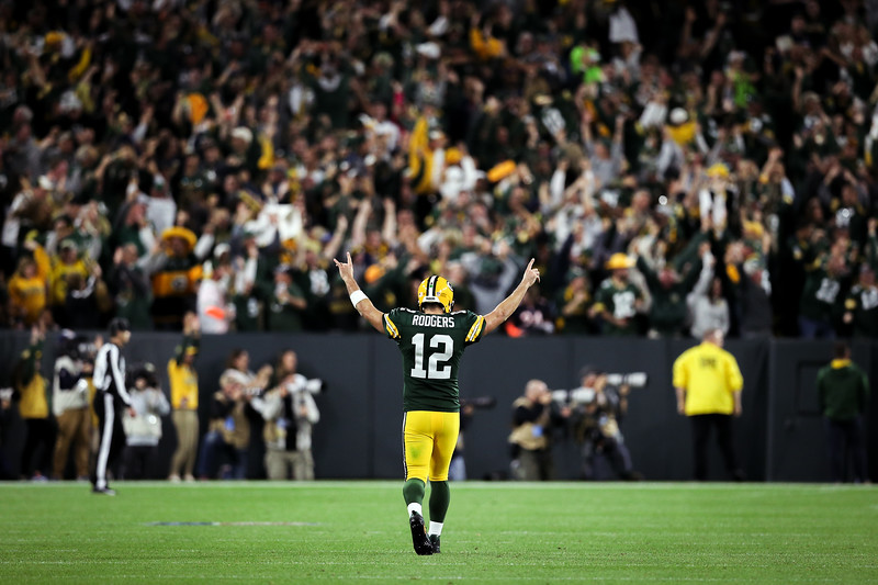 Aaron Rodgers #12 of the Green Bay Packers celebrates after scoring a touchdown in the fourth quarter against the Chicago Bears at Lambeau Field on September 9, 2018 in Green Bay, Wisconsin.