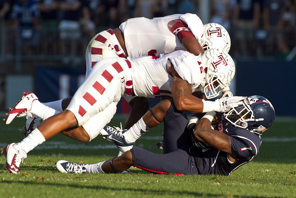 Temple's Sean Chandler and Anthony Robey take down UConn's Dhameer Bradley in the 2nd Quarter of the game at Rentschler Field in East Hartford Saturday, September 27, 2014.