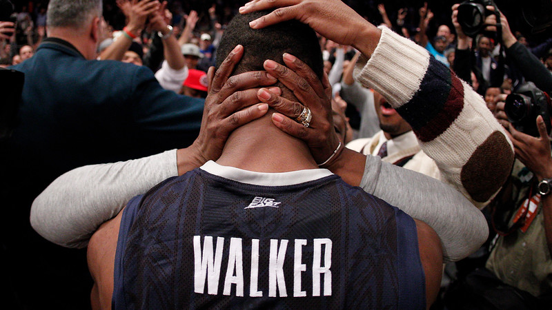 Kemba Walker is embraced by his mother after Connecticut wins the Big East Championship in Madison Square Garden, NY.