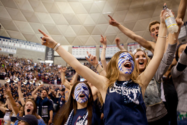 Millie Quevedo, a freshman, right, and her friend Amanda Monaco, left, shout as the University of Connecticut Huskies enter the court on game day Monday, April 8, 2014. Students watched UConn mens basketball play and win against Kentucky on screens at Gample Pavillion at the University of Connecticut in Storrs Monday night.