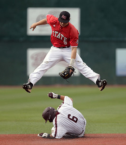 Arkansas State's #5 Tanner Ring tries to put the tag on UALR's #6 Zach Baker during their game at Gary Hogan Field Friday, May 20, 2016.
