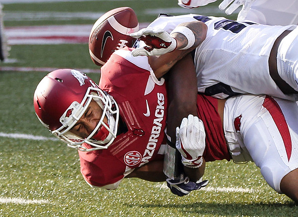 Arkansas' Deon Stewart (13) fumbles the ball during a return after being hit by TCU's Ranthony Texada (11)during their game at Donald W. Reynolds Razorback Stadium in Fayetteville Saturday, September 9, 2017.