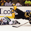 Bruins defenseman Dennis Seidenberg gets tripped and goes airborne by a sliding Mason Raymond. David Le/Salem News