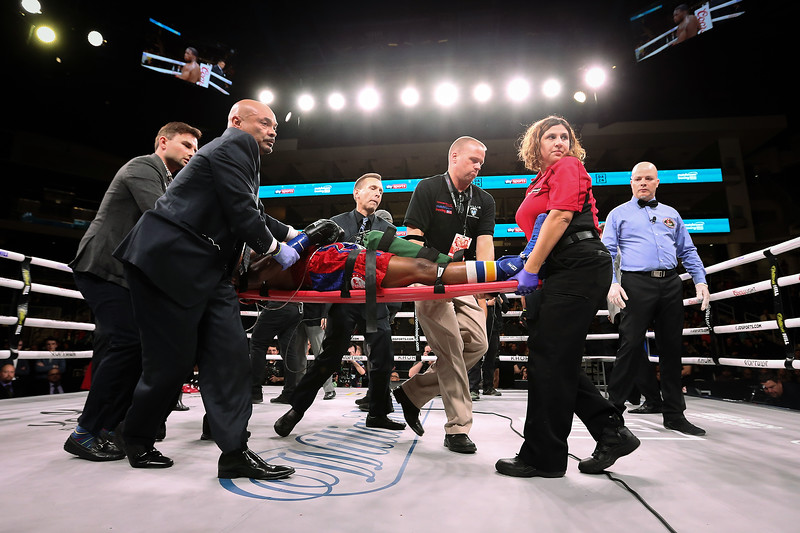 Patrick Day is taken out of the ring on a stretcher after being knocked out by Charles Conwell in the 10th round of their Super-Welterweight bout at Wintrust Arena on October 12, 2019 in Chicago, Illinois. Day died four days later as a result of the injury sustained in the fight.