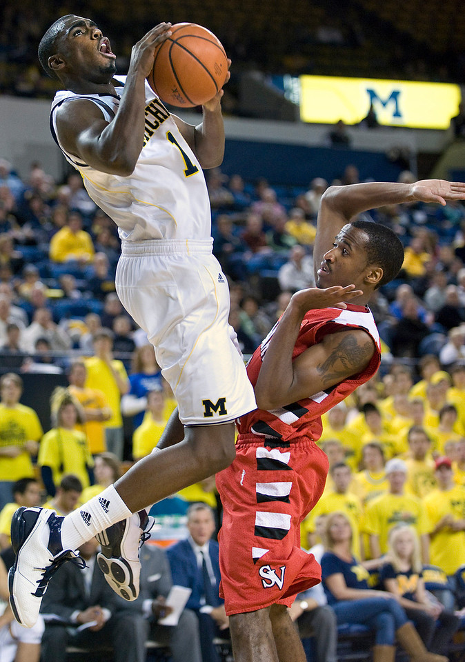 University of Michigan freshman guard Tim Hardaway Jr. shoots over Saginaw Valley State's Chris Webb during an exhibition game at Crisler Arena in Ann Arbor on Nov 5, 2010.  (MARK BIALEK/Special to the Detroit News)