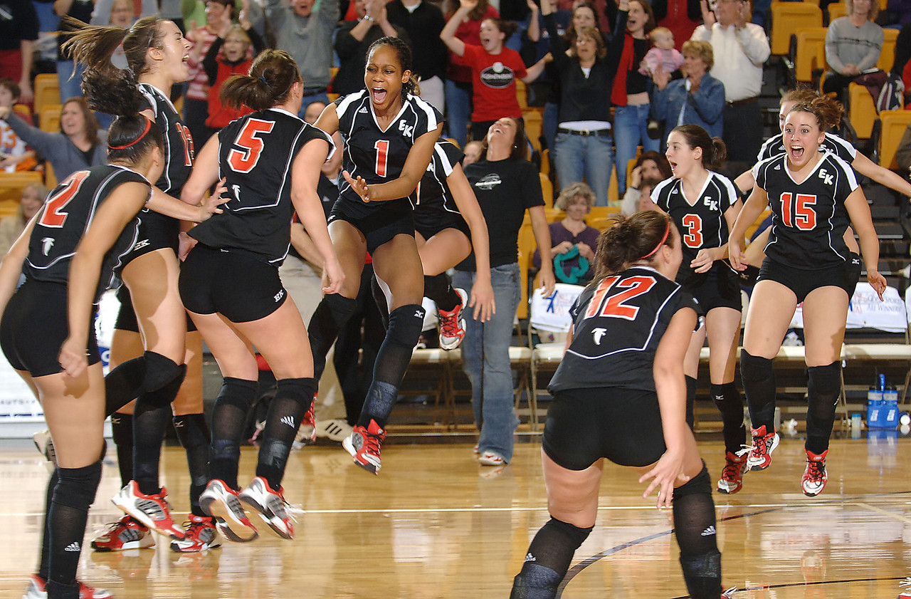 East Kentwood celebrates their 3-2  Class A volleyball Semifinal win over Temperance Bedford at Western Michigan University in Kalamazoo on Thursday, March 16, 2006.  East Kentwood won the match, 3-2, advancing to the finals.  (Mark Bialek / AP)