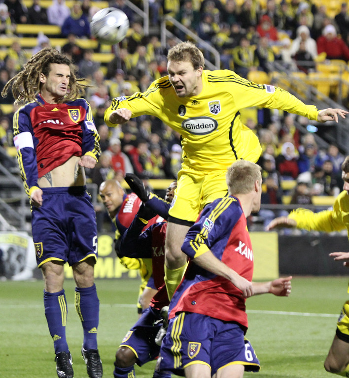 Chris Uhler/Lantern Photographer Columbus Crew defender Chad Marshall leaps up for the ball with Real Salt Lake Capitan Kyle Beckerman. Columbus lost to Salt Lake 3-2.