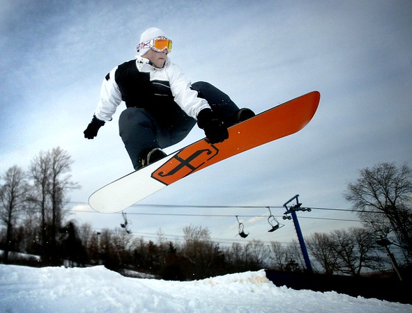 Nick Negretti, 18, a Wolcut resident jump a small ramp on at Mt. Southington in Southington. December 14, 2007.