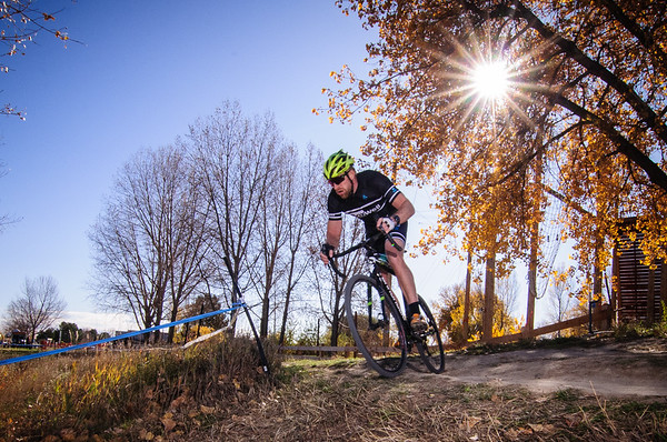 Morning sun shines through the golden autumn leaves during Schoolyard Cross.  Alexander Dawson School, Lafayette, Colorado. October 21, 2017. © Brent Murphy. www.brentmurphyphoto.com @dawsonschool #cyclocross #bikeracing #cyclingphotos #colorado #schoolyardcross