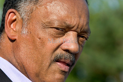 "The Rev. Jesse Jackson speaks to a small crowd as he campaigns for  Christina Montague, who's running for Washtenaw County Commissioner, District 7, in Ann Arbor, MI on July 29, 2012.  Jackson used the opportunity to comment on national issues as well.  ""Guns are for hunting,"" he said, pushing for a ban on assault weapons.  ""We bailed out the banks and now we got to bail out the people,"" he said.  ""Hands that once picked cotton can now pick commissioners and judges and presidents,"" said Jackson."