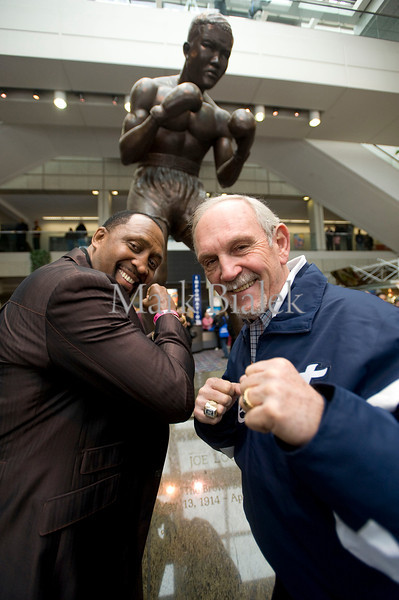 Detroit Tigers manager Jim Leyland and legendary fighter Tommy Hearns pose underneath the Joe Louis statue inside Cobo Hall during the Detroit Auto Show on Jan 20, 2012.  Leyland said he was thrilled when he found out he was going to meet Hearns.