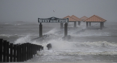 The West Side Pier in Gulfport is battered by the relentless surf spawned by Hurricane Isaac on Wednesday.