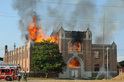 Smoke and flame erupt from the historic Hinds County Armory at the State Fairgrounds in Jackson which caught fire at around 6 p.m. on Tuesday.