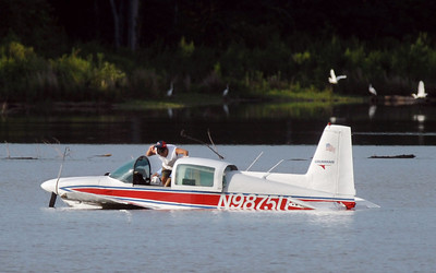 A small airplane sits in a lake in rural Hinds County in Pocahontas Sunday afternoon where the pilot was forced to land after an apparent mechanical problem.  The plane's two occupants both escaped serious injury.