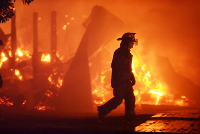 Joe Ellis/The Clarion-Ledger A firefighter walks past the blazing remains of a barn at the Mississippi Agriculture and Forestry Museum in Jackson. Buildings at the museum caught fire late Thursday afternoon. A firefighter walks past blazing wreckage of a barn at the Mississippi Agriculture and Forestry Museum that caught fire late Thursday afternoon.  The Associated Press named this the Mississippi Photo of the Year for 2014.