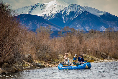 Early season whitewater rafting, with plenty of snow on the peaks for a great season ahead