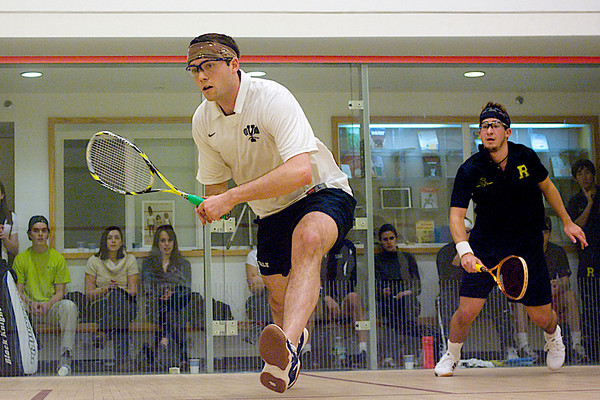 Chris Plimpton (Yale) and Juan Pablo Gaviria (Rochester)<br /> <br /> This photo was published in the March 2010 issue of Squash Magazine (page 31).