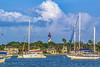 Lighthouse over Matanzas River of Anchored Boats