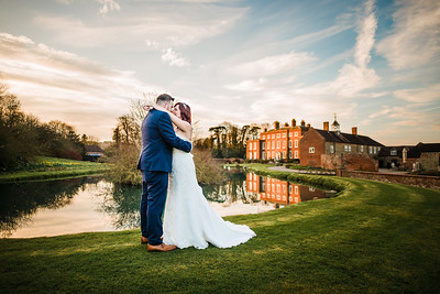 Lakeside Portrait of Bride and Groom at Delbury Hall, Shropshire