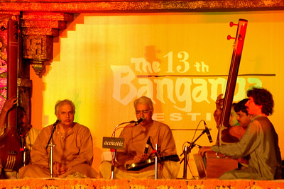 Thirteenth Banganga Festival (Indian music), Mumbai, MH, India by MTDC (Maharashtra Tourism) and Indian Heritage Soceity. Feb'2005.  The sacred waters of the Banganga Tank in Mumbai are a vivid representation of the paradox of traditional life coexisting with unbridled modernization. The temple complex of Banganga is overlooked by many tourists, but is one of Mumbai's holiest sites and the oldest surviving structure in the city.