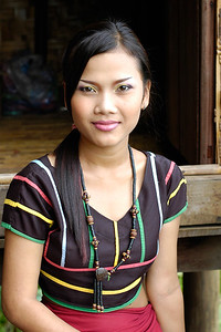 Cambodian girl sitting outside a traditional house before performing various dance forms at the Heritage Village Centre in Siem Reap, Cambodia.