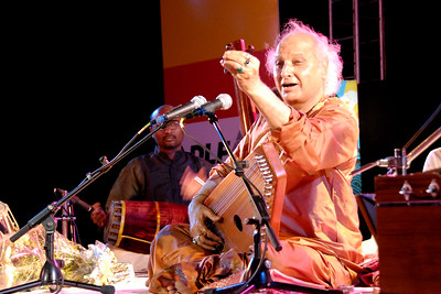 Pandit Jasraj performing at Bandra Bandstand in Mumbai (Bombay) at an event called Mumbai Beat organized by The Times of India and sponsored by DLF group.  Pandit Jasraj (January 28, 1930) is a famous Indian Classical vocalist, and the foremost exponent of the Mewati Gharana in Hindustani classical music.
