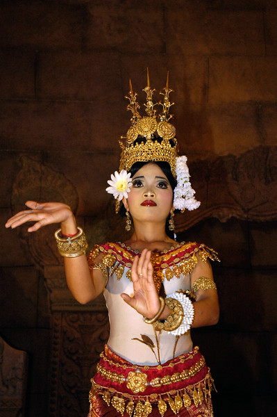 Cambodian girl performing traditional dance with vivid hand motions similar to Thai dance in Siem Reap, Cambodia.
