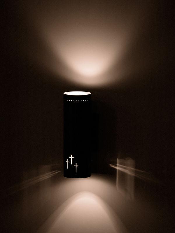 Interior lamp inside a church sanctuary.