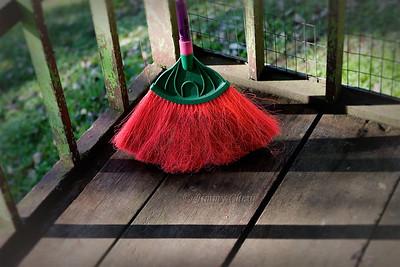 Broom on verandah.