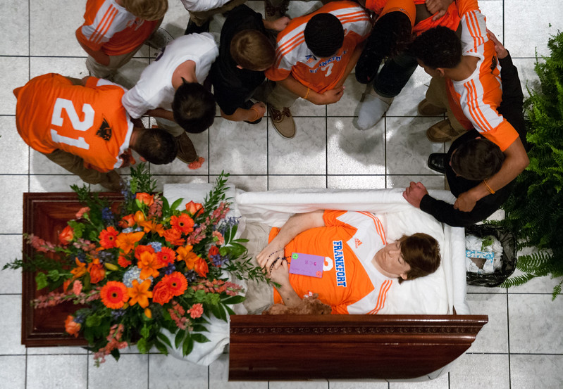 Members of the Frankfort soccer team view Bradley Camic for the last time during his funeral at the Frankfort Convention Center in Frankfort, Kentucky.