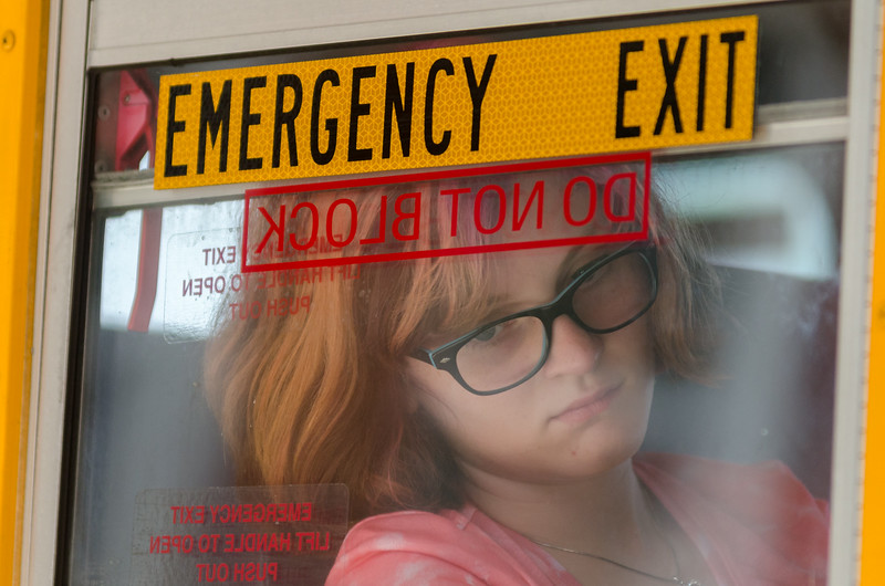 A Second Street Elementary student looks out the window of her school bus after the first day of school in Frankfort, Kentucky.