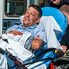 Mail carrier John Dampier winces as he is taken into an ambulance after being bitten by a dog in Frankfort, Kentucky.