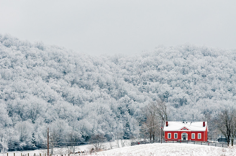 A house sits at the base of a hill after an overnight snowfall in Peaks Mill, Kentucky.