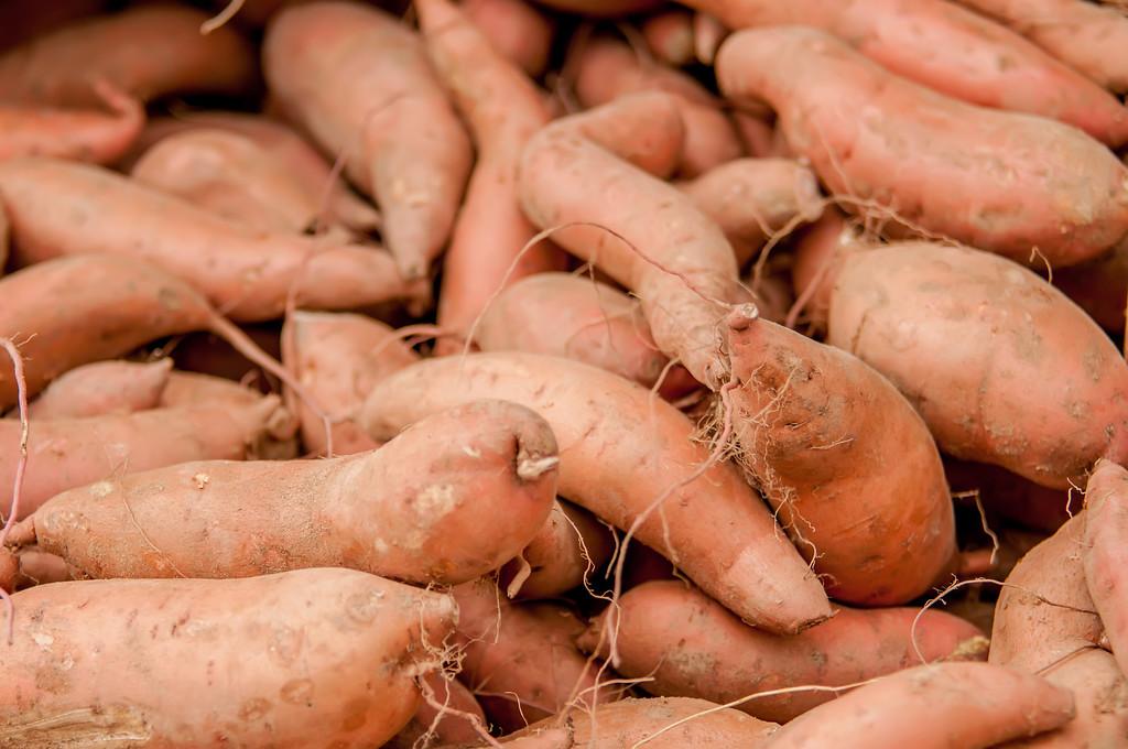 sweet potatoes on a farm display