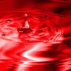red multi colored water drop bubbling