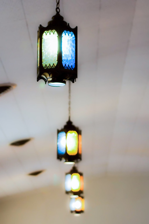 rustic lights on church ceiling