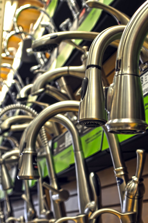 rows of faucets on display for sale at store