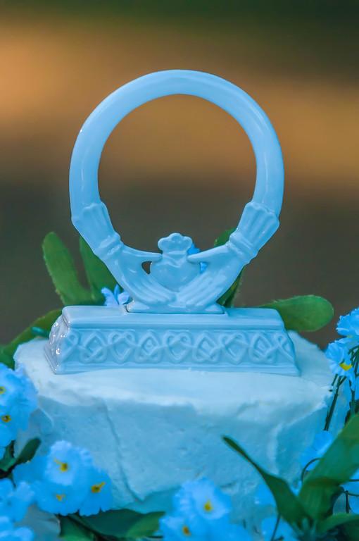 Closeup detail of white wedding cake at reception