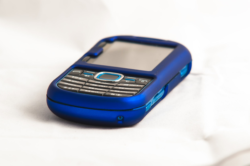 blue cell phone isolated on the white background.