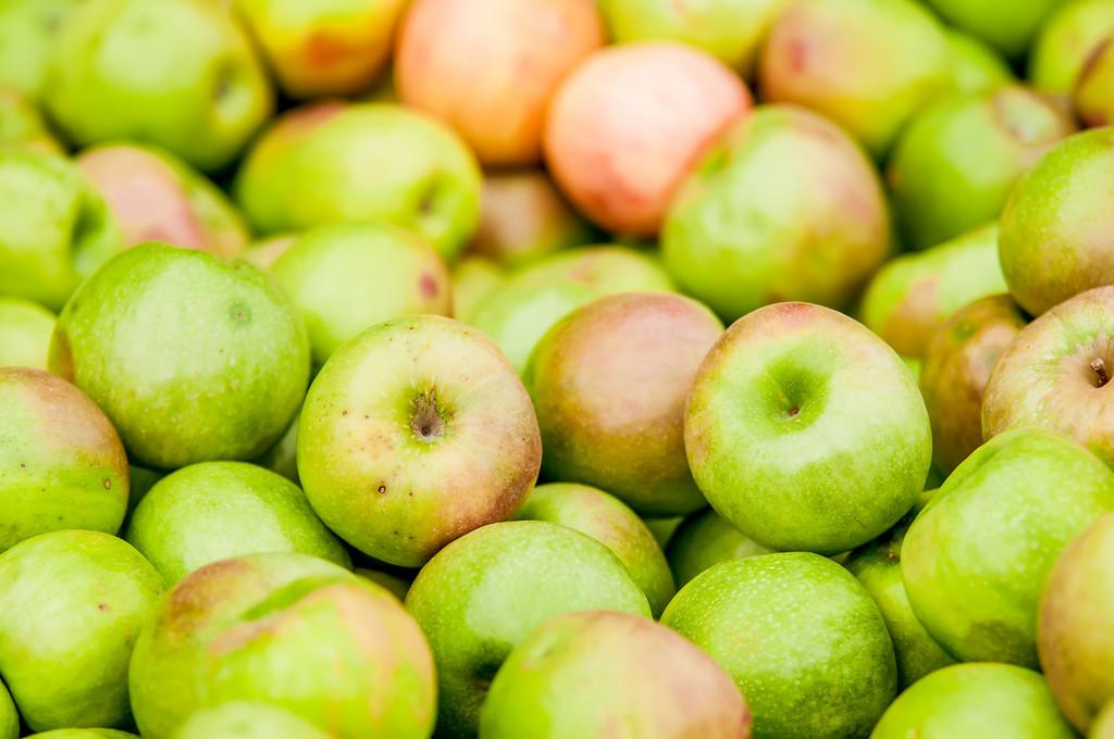 Freshly harvested colorful crimson crisp apples on display at the farmers market